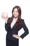 Business woman with piggy bank Stock Photo