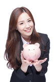 Business woman with piggy bank Stock Image