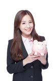 Business woman with piggy bank Royalty Free Stock Photo