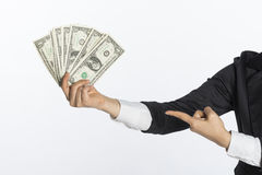 Business woman with a piggy bank to get hold dollars. Is a savings concept Stock Images
