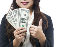 Business woman with a piggy bank to get hold dollars Stock Photography