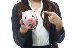 Business woman with a piggy bank to get hold dollars Stock Images