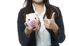 Business woman with a piggy bank to get hold dollars Royalty Free Stock Photos