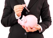 Business woman with piggy bank and tweezers in han Royalty Free Stock Image