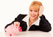 Business woman with piggy bank Royalty Free Stock Image