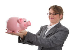 Business woman with piggy bank - woman isolated on white backgro Stock Photos