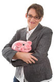 Business woman with piggy bank - woman isolated on white backgro Stock Image