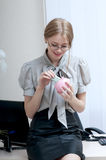 Business woman with  a piggy bank. Royalty Free Stock Photography