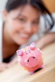 Business woman with a piggybank Royalty Free Stock Photo