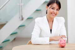 Business woman with a piggybank Royalty Free Stock Photography