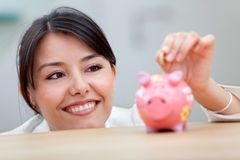 Business woman with a piggybank Stock Images
