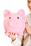 Business woman with a piggybank. Royalty Free Stock Photography