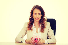 Business woman with a piggybank. Royalty Free Stock Images