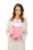 Business woman with a piggybank. Stock Photos