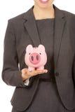 Business woman with piggybank. Stock Photography