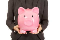 Business woman with piggybank. Stock Photo