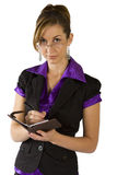 Business Woman planning her day. Sophisticated business woman, writing an appointment down in her diary Stock Images