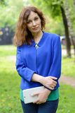Business woman planning her day in the park Stock Photography