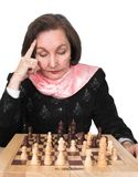 Business woman planning her next move - chess Stock Images