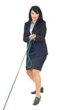 Business woman play tug of war Royalty Free Stock Images