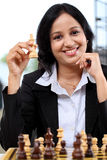Business woman playing chess Stock Photo