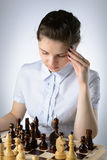 Business woman playing chess Stock Photos