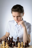 Business woman playing chess Stock Photography