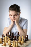 Business woman playing chess Royalty Free Stock Image