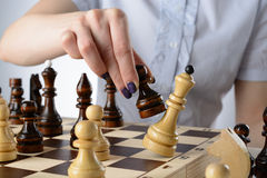 Business woman playing chess Royalty Free Stock Photography