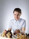 Business woman playing chess Royalty Free Stock Photos