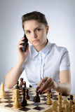 Business woman playing chess Stock Images