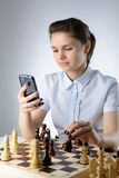 Business woman playing chess Royalty Free Stock Images