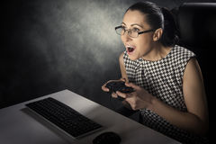 Business woman playing computer games Stock Photography