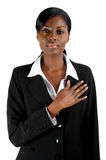 Business woman pledging. This is an image of business woman with hand across his chest Stock Photos