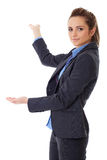 Business woman point back with her hand, isolated Royalty Free Stock Photos