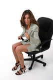 Business Woman Pointing 1. Beautiful brunette executive business woman in a business suit sitting in office chair, pointing and gesturing as if to give a warning stock photography