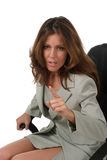 Business Woman Pointing 3. Beautiful brunette executive business woman in a business suit sitting in office chair, pointing and gesturing as if to give a warning Royalty Free Stock Photo