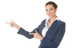 Business woman is pointing aside. Royalty Free Stock Photo