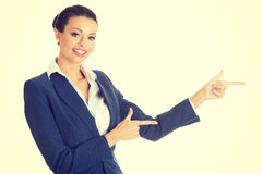 Business woman is pointing aside. Royalty Free Stock Photography