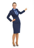Business woman pointing behind on copy space Royalty Free Stock Image