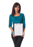 Business woman pointing in blank clipboard Royalty Free Stock Photography