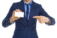 Business woman pointing on business card Royalty Free Stock Photography