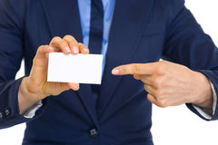 Business woman pointing on business card Royalty Free Stock Photo