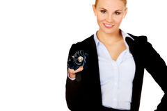 Business woman pointing on camera with umbrella Stock Image