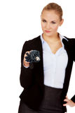 Business woman pointing on camera with umbrella Stock Photos