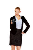 Business woman pointing on camera with umbrella Stock Photo