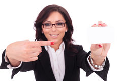 Business woman pointing at card Stock Image