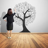 Business woman pointing  concept picture of idea tree on wood  f Stock Photos