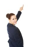 Business woman pointing on copy space. Royalty Free Stock Photos
