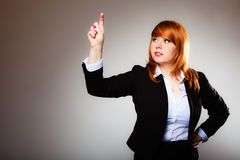 Business woman pointing copy space. Business woman pointing with finger empty copy space, businesswoman showing side, concept advertisement product push touch Royalty Free Stock Photography